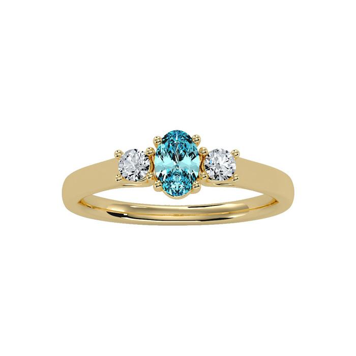 1/2 Carat Oval Shape Aquamarine & Two Diamond Ring in 14K Yellow