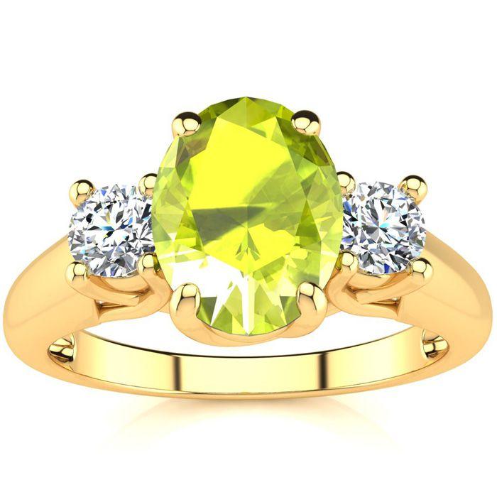 1.5 Carat Oval Shape Peridot & Two Diamond Ring in 14K Yellow Gol
