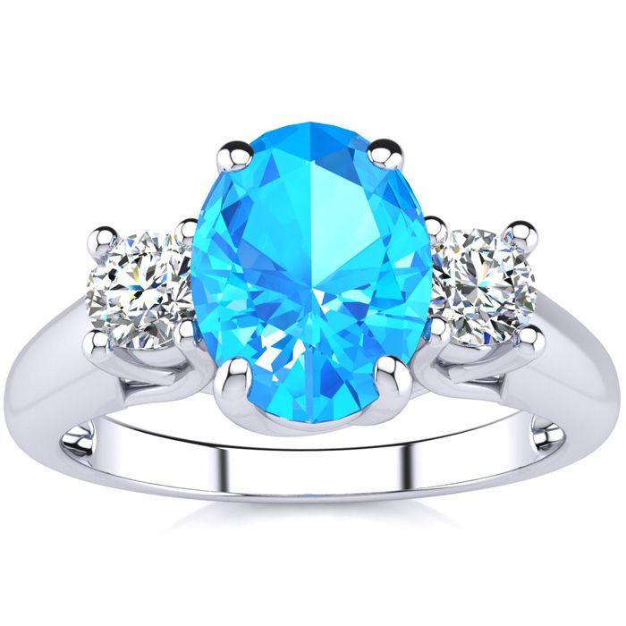 1 3/4 Carat Oval Shape Blue Topaz & Two Diamond Ring in 14K White