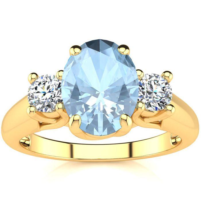 1 1/3 Carat Oval Shape Aquamarine & Two Diamond Ring in 14K Yellow Gold (3.1 g), I/J by SuperJeweler