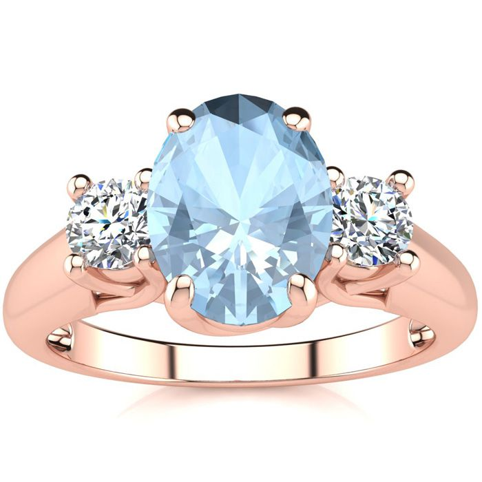 1 1/3 Carat Oval Shape Aquamarine & Two Diamond Ring in 14K Rose