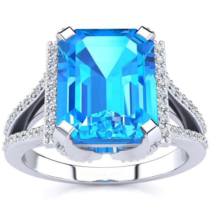 4 1/3 Carat Emerald Cut Blue Topaz and Halo Diamond Ring In 14 Karat White Gold