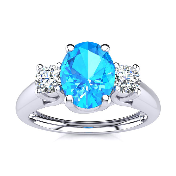 1 1/5 Carat Oval Shape Blue Topaz & Two Diamond Ring in 14K White