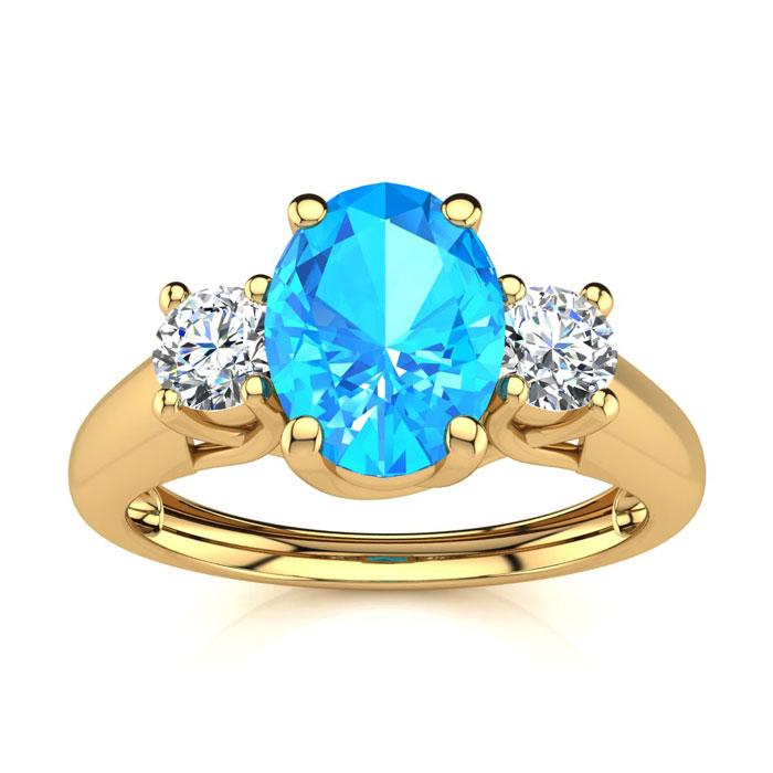 1 1/5 Carat Oval Shape Blue Topaz & Two Diamond Ring in 14K Yello