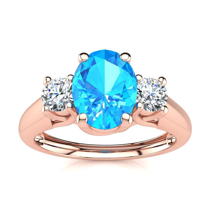 1 1/5 Carat Oval Shape Blue Topaz & Two Diamond Ring in 14K Rose
