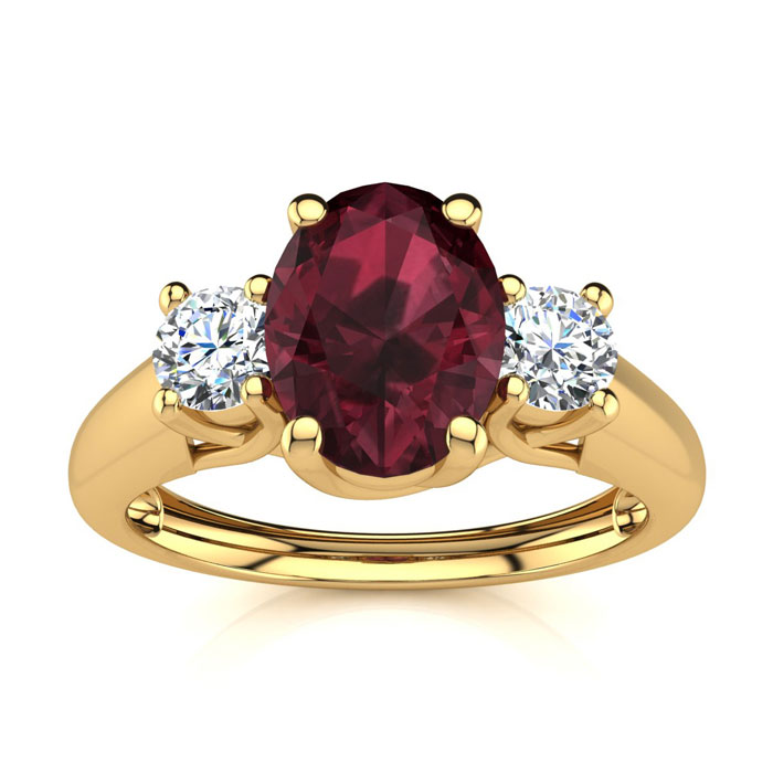 1 1/5 Carat Oval Shape Garnet & Two Diamond Ring in 14K Yellow Go