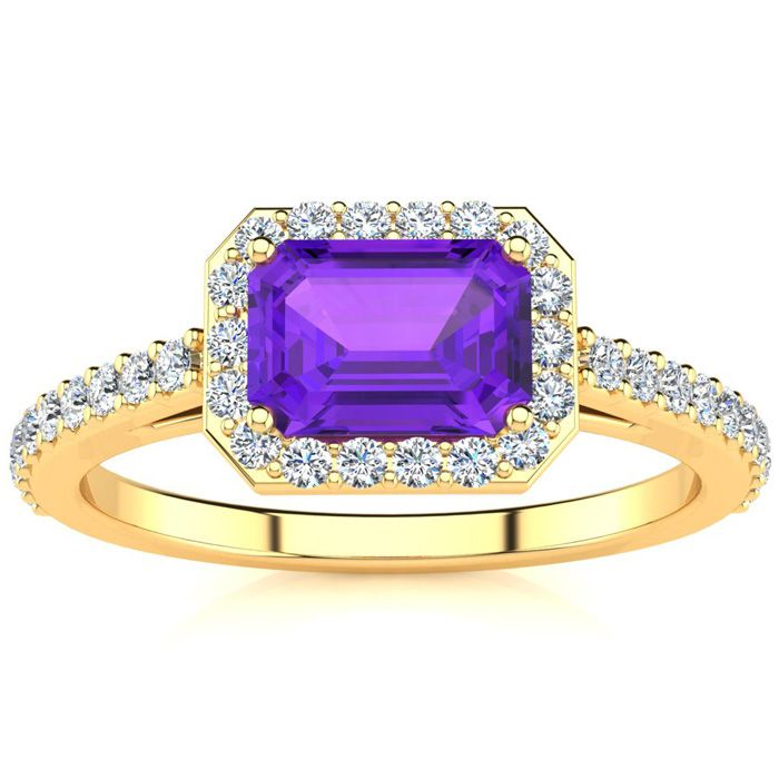 1 1/4 Carat Emerald Shape Amethyst and Halo Diamond Ring In 14 Karat Yellow Gold