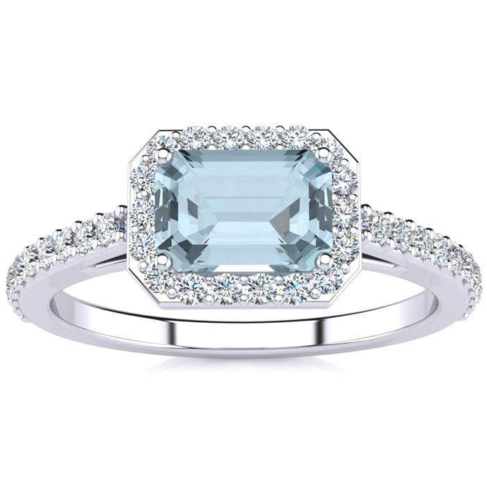 1 1/4 Carat Emerald Shape Aquamarine and Halo Diamond Ring In 14 Karat White..