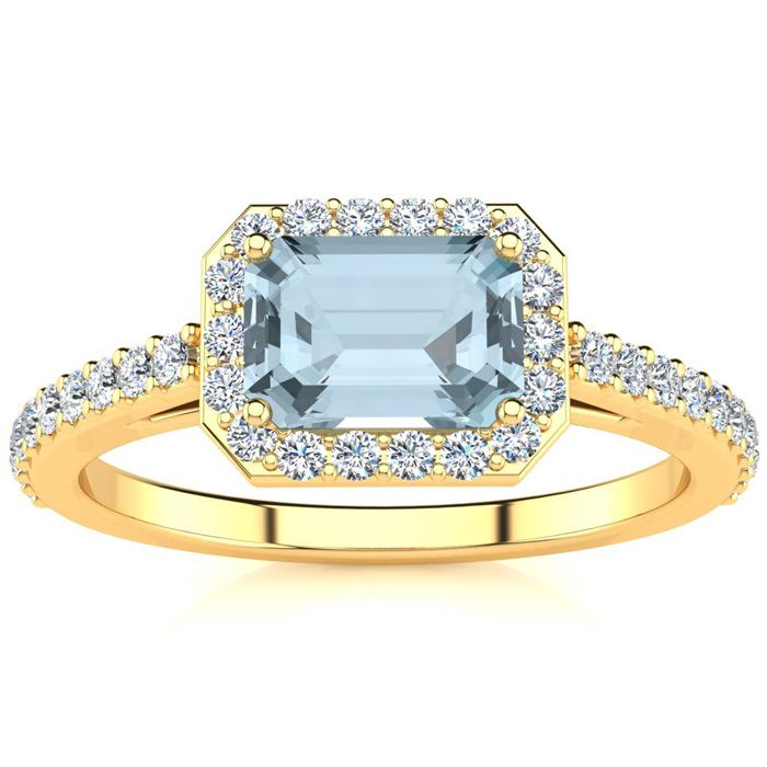 1 1/4 Carat Emerald Shape Aquamarine and Halo Diamond Ring In 14 Karat Yellow Gold
