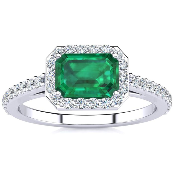1 1/4 Carat Emerald Shape Emerald and Halo Diamond Ring In 14 Karat White Gold