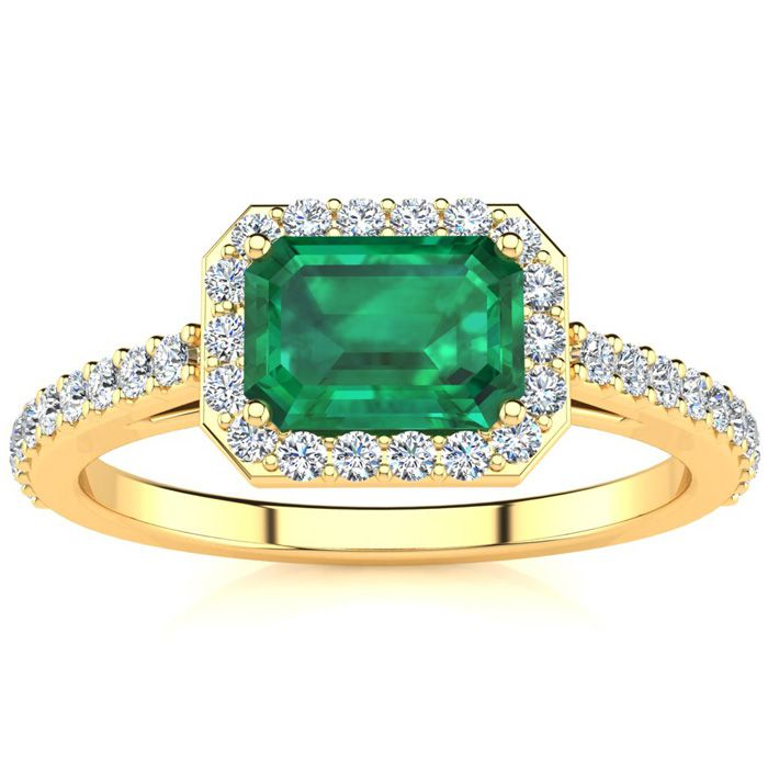 1 1/4 Carat Emerald Shape Emerald and Halo Diamond Ring In 14 Karat Yellow Gold
