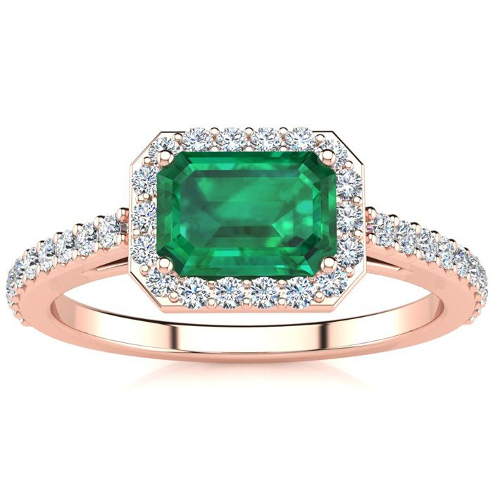 1 1/4 Carat Emerald Shape Emerald and Halo Diamond Ring In 14 Karat Rose Gold