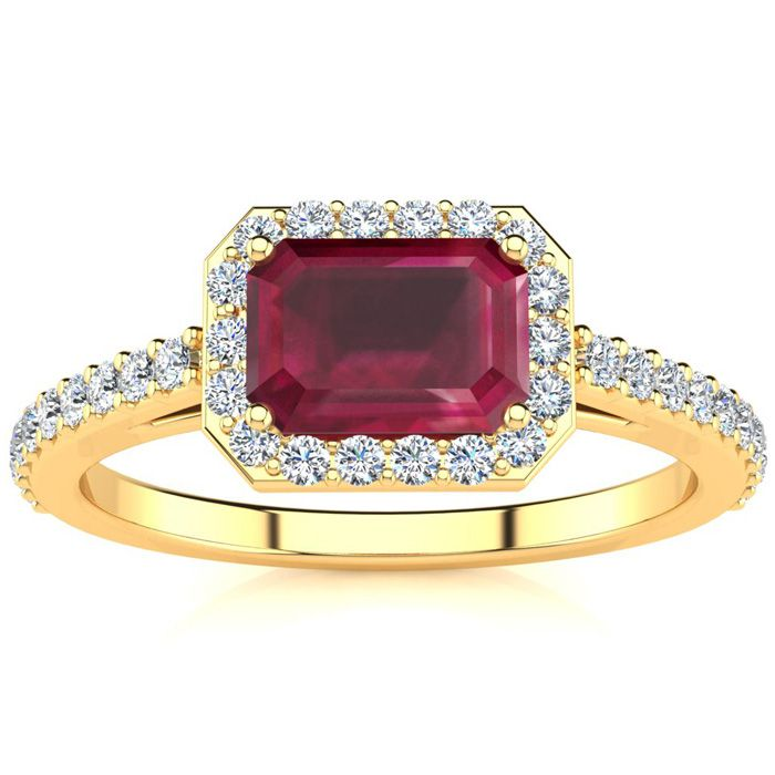 1 1/3 Carat Emerald Shape Ruby and Halo Diamond Ring In 14 Karat Yellow Gold