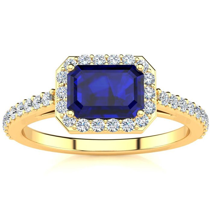 1 1/2 Carat Emerald Shape Sapphire and Halo Diamond Ring In 14 Karat Yellow Gold