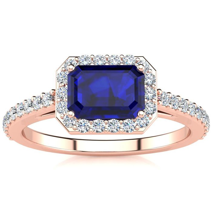 1 1/2 Carat Emerald Shape Sapphire and Halo Diamond Ring In 14 Karat Rose Gold