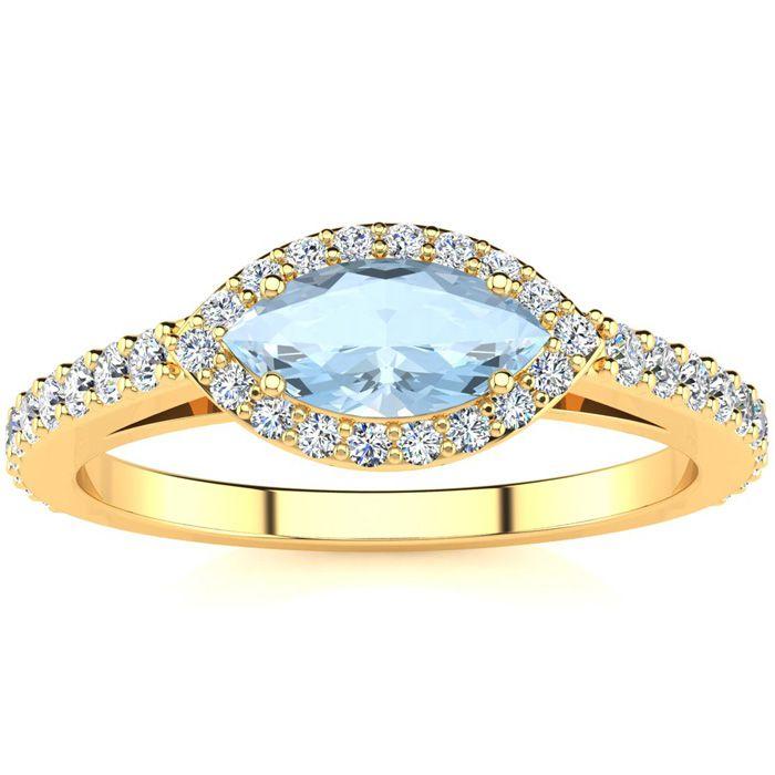 3/4 Carat Marquise Shape Aquamarine and Halo Diamond Ring In 14 Karat Yellow..