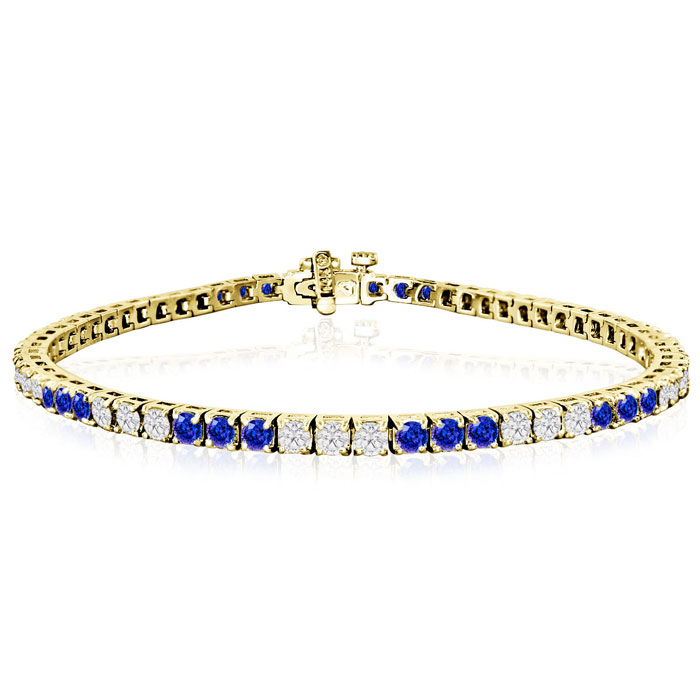 Fine quality 5 Carat Tanzanite and Diamond Bracelet in 14k Yellow Gold