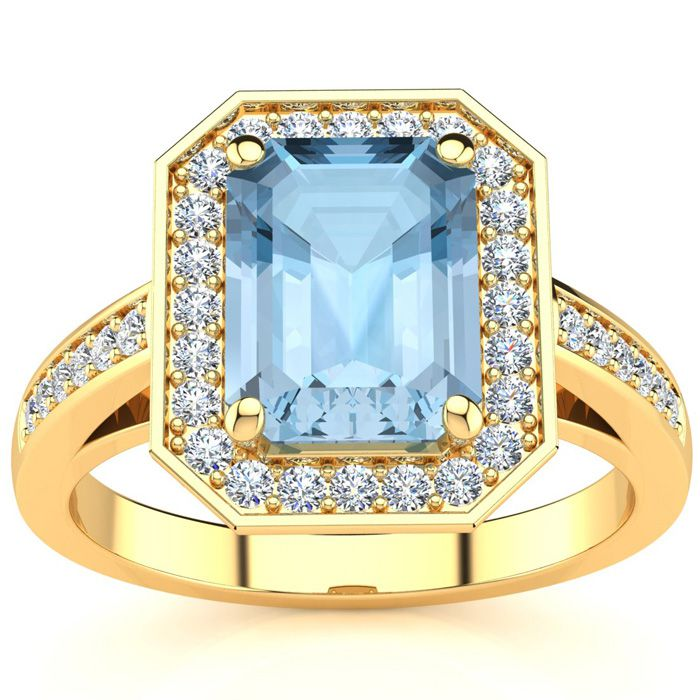 1 3/4 Carat Emerald Shape Aquamarine and Halo Diamond Ring In 14 Karat Yellow Gold