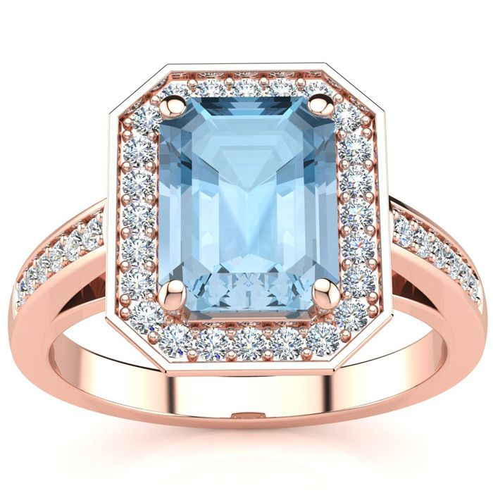 1 3/4 Carat Emerald Shape Aquamarine and Halo Diamond Ring In 14 Karat Rose Gold