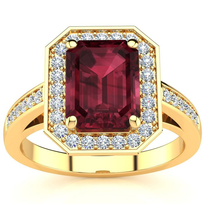 2 1/4 Carat Emerald Shape Garnet and Halo Diamond Ring In 14 Karat Yellow Gold