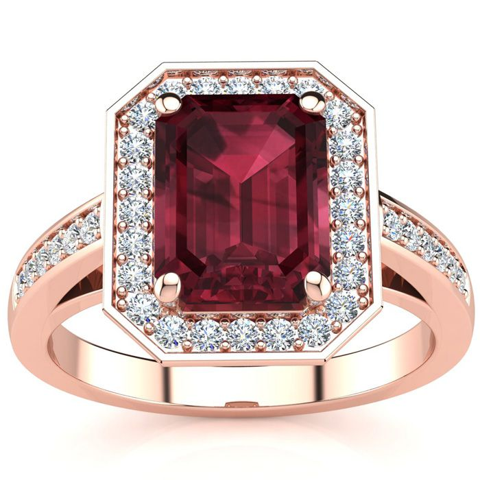 2 1/4 Carat Emerald Shape Garnet and Halo Diamond Ring In 14 Karat Rose Gold