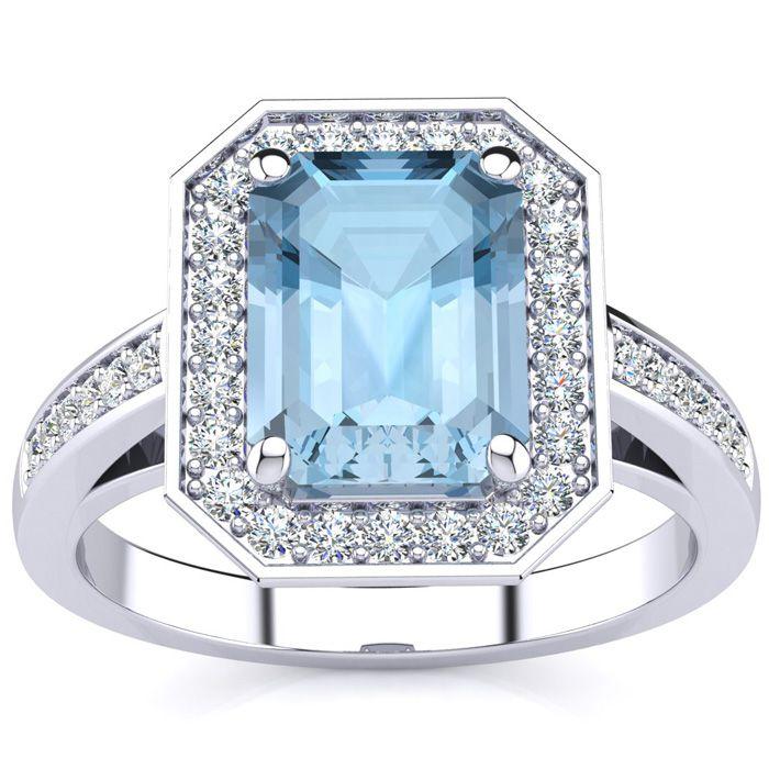 2 1/2 Carat Emerald Shape Aquamarine and Halo Diamond Ring In 14 Karat White..