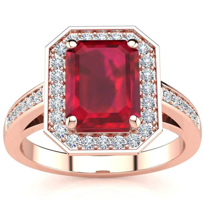 3 1/3 Carat Emerald Shape Ruby and Halo Diamond Ring In 14 Karat Rose Gold