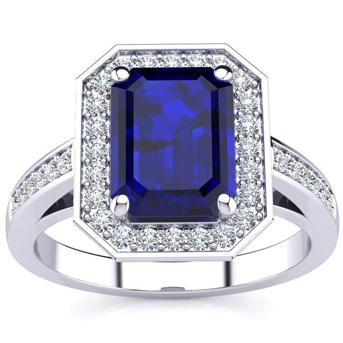 3 1/3 Carat Emerald Shape Sapphire and Halo Diamond Ring In 14 Karat White Gold