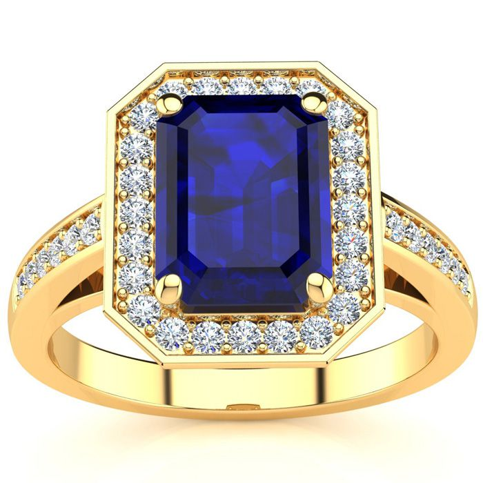 3 1/3 Carat Emerald Shape Sapphire and Halo Diamond Ring In 14 Karat Yellow Gold