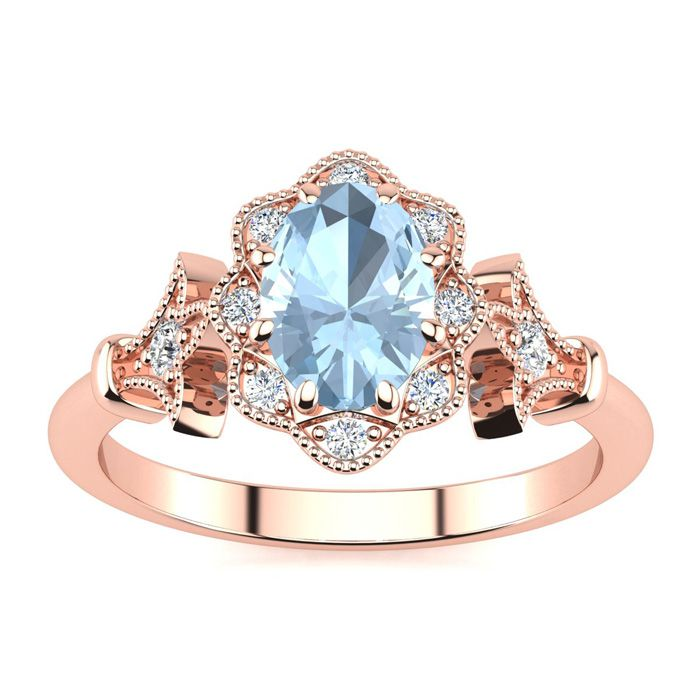 1 Carat Oval Shape Aquamarine and Halo Diamond Vintage Ring In 14 Karat Rose Gold