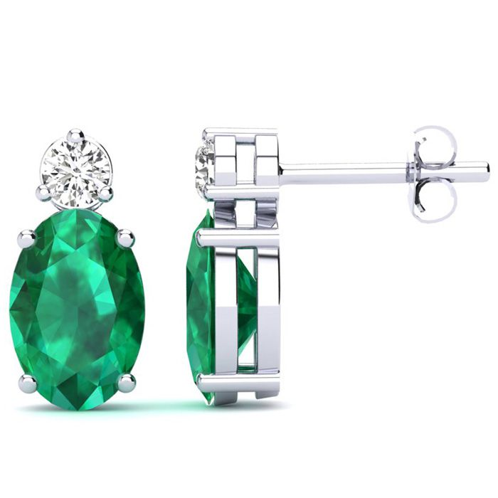 1 1/2 Carat Oval Emerald and Diamond Stud Earrings In 14 Karat White Gold