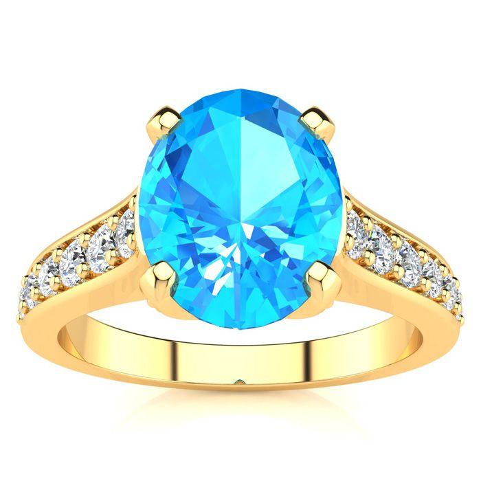 2.5 Carat Oval Shape Blue Topaz & 12 Diamond Ring in 14K Yellow Gold (4.20 g..