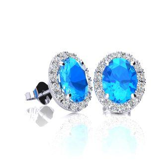 1 1/4 Carat Oval Shape Blue Topaz and Halo Diamond Stud Earrings In 14 Karat White Gold