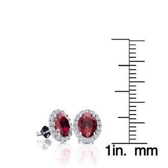 1 1/4 Carat Oval Shape Ruby and Halo Diamond Stud Earrings In 10 Karat White Gold