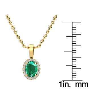 0.90 Carat Oval Shape Emerald and Halo Diamond Necklace In 14 Karat Yellow Gold With 18 Inch Chain