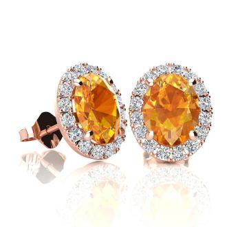 1 1/2 Carat Oval Shape Citrine and Halo Diamond Stud Earrings In 14 Karat Rose Gold