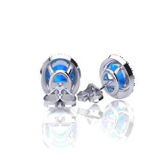 2 1/4 Carat Oval Shape Blue Topaz and Halo Diamond Stud Earrings In 14 Karat White Gold