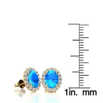 2 1/4 Carat Oval Shape Blue Topaz and Halo Diamond Stud Earrings In 10 Karat Yellow Gold
