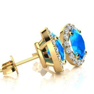 2 1/4 Carat Oval Shape Blue Topaz and Halo Diamond Stud Earrings In 14 Karat Yellow Gold