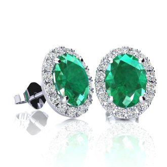 1 3/4 Carat Oval Shape Emerald and Halo Diamond Stud Earrings In 10 Karat White Gold