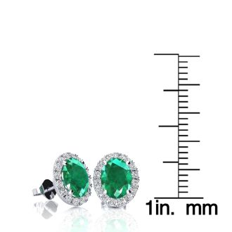 1 3/4 Carat Oval Shape Emerald and Halo Diamond Stud Earrings In 14 Karat White Gold