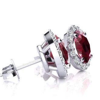 2 Carat Oval Shape Ruby and Halo Diamond Stud Earrings In 10 Karat White Gold