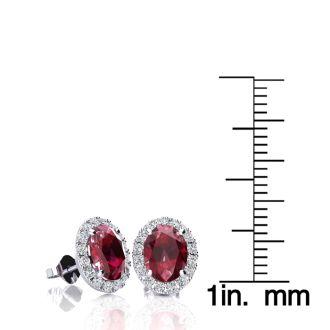 2 Carat Oval Shape Ruby and Halo Diamond Stud Earrings In 14 Karat White Gold