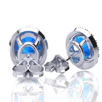 3 1/4 Carat Oval Shape Blue Topaz and Halo Diamond Stud Earrings In 14 Karat White Gold