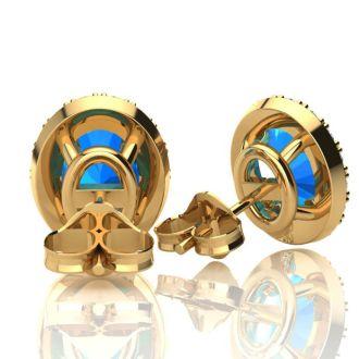 3 1/4 Carat Oval Shape Blue Topaz and Halo Diamond Stud Earrings In 10 Karat Yellow Gold