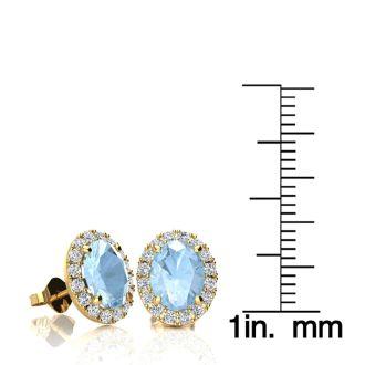 2 1/2 Carat Oval Shape Aquamarine and Halo Diamond Stud Earrings In 14 Karat Yellow Gold