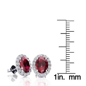 3.40 Carat Oval Shape Ruby and Halo Diamond Stud Earrings In 14 Karat White Gold
