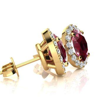3.40 Carat Oval Shape Ruby and Halo Diamond Stud Earrings In 14 Karat Yellow Gold