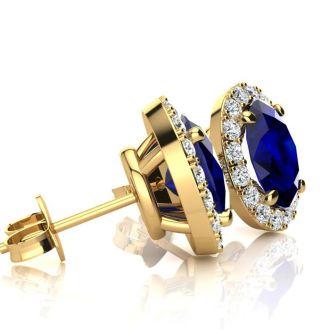 3 1/2 Carat Oval Shape Sapphire and Halo Diamond Stud Earrings In 14 Karat Yellow Gold