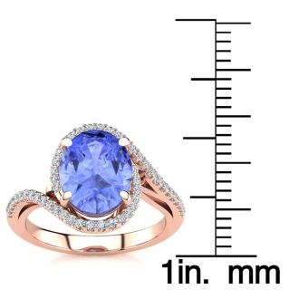 2 3/4 Carat Oval Shape Tanzanite and Halo Diamond Ring In 14 Karat Rose Gold